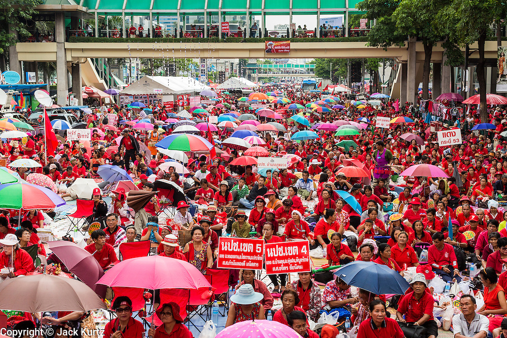 19 MAY 2013 - BANGKOK, THAILAND:  Red Shirts crowd into Ratchaprasong during a Red Shirt rally in Ratchaprasong Intersection honoring Red Shirts killed by the Thai army in 2010. More than 85 people, most of them civilians, were killed during the Thai army crackdown against the Red Shirt protesters in April and May 2010. The Red Shirts were protesting against the government of Abhisit Vejjajiva, a member of the opposition who became Prime Minister after Thai courts ruled the Red Shirt supported government was unconstitutional. The protests rocked Bangkok from March 2010 until May 19, 2010 when Thai troops swept through the protest areas arresting hundreds.   PHOTO BY JACK KURTZ