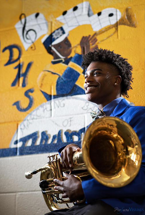 """Khairy Jenkins is the author of the book, """"If My Horn Could Speak."""" It's this self-help book for kids his age. He'll graduate from Dudley and head to A&T in the fall where he'll play in the band and work toward becoming a veterinarian.<br /> <br /> <br /> Photographed, Thursday, May 17, 2018, in Greensboro, N.C. JERRY WOLFORD and SCOTT MUTHERSBAUGH / Perfecta Visuals"""