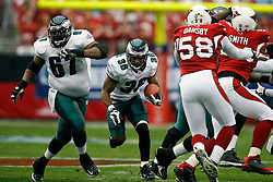 18 Jan 2009: Philadelphia Eagles running back Brian Westbrook #36 runs the ball with offensive lineman Jamaal Jackson #67 blocking during the NFC Championship game against the Arizona Cardinals on January 18th, 2009. The Cardinals won 32-25 at University of Phoenix Stadium in Glendale, Arizona. (Photo by Brian Garfinkel)