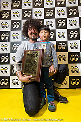 Kaichiroh Kurosu of Cherry's Company with his First Place award and his son at the Annual Mooneyes Yokohama Hot Rod and Custom Show. Japan. Sunday, December 7, 2014. Photograph ©2014 Michael Lichter.