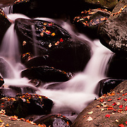 Roaring Fork tumbles over rocks and autumn leaves in Great Smoky Mountains National Park, TN - NC.
