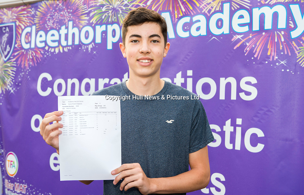 """23 Aug 2018: Cleethorpes Academy GCSE results<br /> Daniel Chapman opens his results with his parents. Daniel got 9 GCSE's including a 9 in Maths and a 9 in Combined Science. <br /> """"I'm delighted. I'm going to college to do computer science. I came  in on weekends and after school for revision. Staff were great. I couldn't have done it without them.""""<br /> <br /> Picture: Sean Spencer/Hull News & Pictures Ltd<br /> 01482 210267/07976 433960<br /> www.hullnews.co.uk         sean@hullnews.co.uk"""