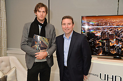 First look of the new Samsung Curved UHD TV at the Candy & Candy penthouse at No. 1 Arlington Street, London - an exclusive Samsung BlueHouse event held on 27th February 2014.<br /> Picture shows:- Isaac Ferry and Robert King,Vice President, Consumer Electronics, Samsung UK