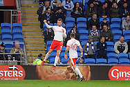 Barnsley's Sam Winnall (in air) celebrates after he scores his teams 1st and equalising goal.  EFL Skybet championship match, Cardiff city v Barnsley at the Cardiff city stadium in Cardiff, South Wales on Saturday 17th December 2016.<br /> pic by Carl Robertson, Andrew Orchard sports photography.