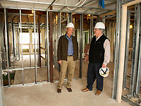 Dick Weaver and Tom Cochran of Laconia Housing take a walk-through of the 3rd floor of the Sunrise House building project on Wednesday morning.  (Karen Bobotas/for the Laconia Daily Sun)