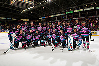 KELOWNA, CANADA - NOVEMBER 3: The Kelowna Rockets' pose for a photo on the ice after Pink the Rink night  on November 3, 2018 at Prospera Place in Kelowna, British Columbia, Canada.  (Photo by Marissa Baecker/Shoot the Breeze)