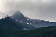 Storm clounds begin rolling over Pyramid Peak in North Cascades National Park, Washington State, USA