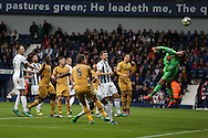 Ben Foster, the West Bromwich Albion goalkeeper ® makes a save. Premier league match, West Bromwich Albion v Tottenham Hotspur at the Hawthorns stadium in West Bromwich, Midlands on Saturday 15th October 2016. pic by Andrew Orchard, Andrew Orchard sports photography.