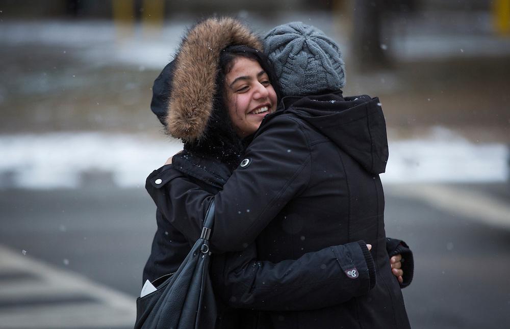 Syrian refugee Rania Batal Al Hasan (left) hugs her english translator in Mississauga, Ontario, Canada, Thursday January 21, 2016.   (Mark Blinch for the BBC)