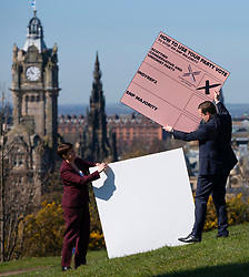 Edinburgh, Scotland, UK. 15 April 2021. Leader of Scottish Conservatives Douglas Ross and Ruth Davidson put a giant party list vote into a giant envelope on Calton Hill in Edinburgh today. Iain Masterton/Alamy Live News