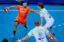 The Dutch handball player Jorn Smits in action against Jure Dolenec from Slovenia during the European Championship qualifying match on January 6, 2020 in Topsportcentrum Almere