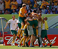 Photo: Glyn Thomas.<br />Australia v Japan. Group F, FIFA World Cup 2006. 12/06/2006.<br />Australia's Tim Cahill is mobbed by teammates after scoring his and his side's second goal.