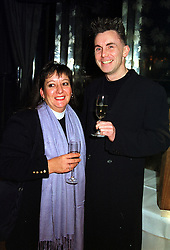 Top chef GARY RHODES and his wife JENNY RHODES, at a party in London on 20th December 1999.MZZ 31