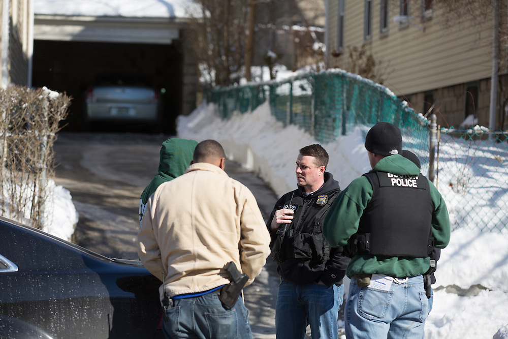 Boston, MA 02/07/2014<br /> Boston Police officers secure a house at 650 Walk Hill St in Mattapan where the gun used in Friday's shooting of a 9 year old boy was reportedly recovered.<br /> Alex Jones / www.alexjonesphoto.com