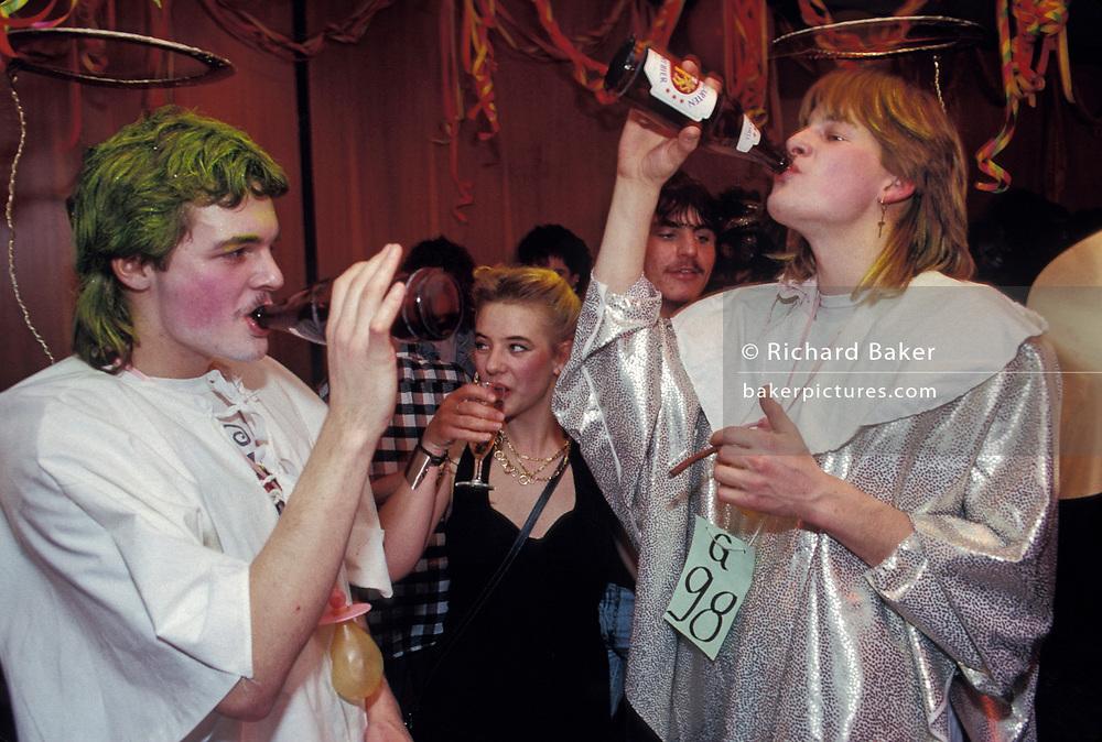 Young people drink beers during a fancy dress party in a Liechtenstein village hall, on 8th February 1990, in Gamprin, Liechtenstein.