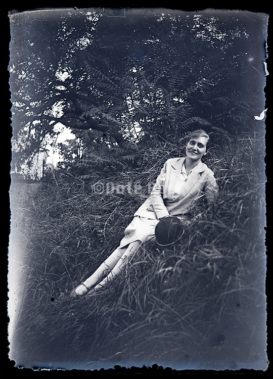 adult woman casual posing on grass slope France circa 1930s