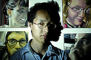 LOCAL MATTERS..TOD / Ottawa / Aug 2, 2005...Kenji Toyooka, 28,  who is an acrylic painter is pictured at his home studio in Ottawa on Aug 2, 2005..(Ottawa Sun Photo By Sean Kilpatrick) #3915