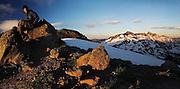 HIker Dallas Anderson sits on a boulder on Hawkeye Point, Goat Rock Wilderness, Washington.