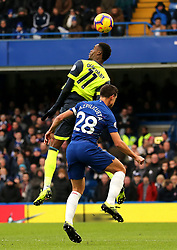 Huddersfield Town's Adama Diakhaby (left) and Chelsea's Cesar Azpilicueta (right) battle for the ball in the air