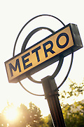Metro sign in the early morning sunshine in Paris, France