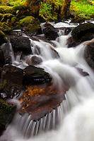 Secret waterfall spills over boulders on Kodiak Island