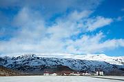 Dwellings and Porvaldseyri farm under Eyjafjallajokull glacier scene of recent volcanic eruption, Thorsmork Valley, Katla Geopark South Iceland