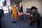 The second day of the Strike WEF march to Davos on 20th of January 2020 in Klosters, Switzerland. Clowns from the Clown Army points out a special WEF lunch offer.  The march started in Schiers and walked the 24 kilomers to Klosters.  The aim is to finish in Davos with a public meeting in the town on the day the WEF begins. The march is a three day protest against the World Economic Forum meeting in Davos. The activists want climate justice and think that The WEF is for the worlds richest and political elite only.