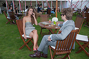 JOANNA GREEN; PATRICK KEOGH, Cartier International Polo. Smiths Lawn. Windsor. 24 July 2011. <br /> <br />  , -DO NOT ARCHIVE-© Copyright Photograph by Dafydd Jones. 248 Clapham Rd. London SW9 0PZ. Tel 0207 820 0771. www.dafjones.com.