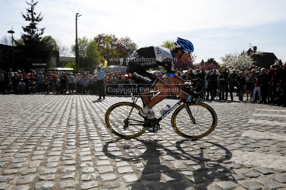 France Apr 10, 2011: Garmin Cervelo's Johan van Summeren races round a cobbled corner in Gruson on the way to winning the 2011 edition of the Paris Roubaix cycle race. Copyright 2011 Peter Horrell