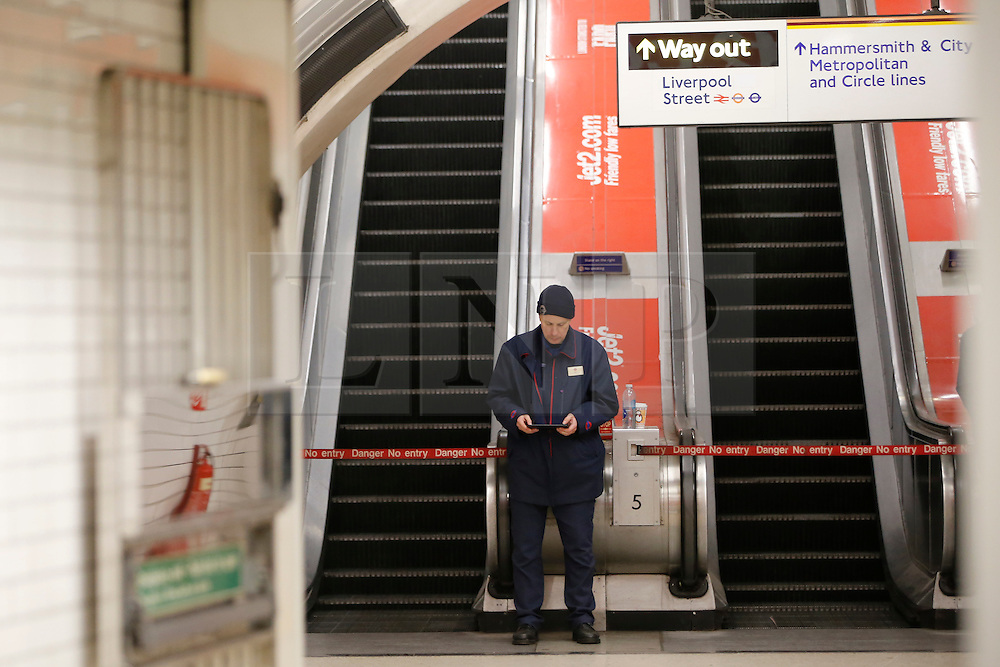 © Licensed to London News Pictures. 08/01/2017. London, UK. TfL staff guard closed escalators at Liverpool Street tube station as London Underground services are severely disrupted due to members of RMT and TSSA unions' 24 hour strike action in a dispute over jobs cuts and closed ticket offices on Sunday, 8 January 2017. The strike action also will be effective all day on Monday, 9 January 2017. Photo credit: Tolga Akmen/LNP