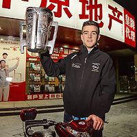 28 November 2013; Clare's Tony Kelly, with the Liam MacCarthy cup, at a local market area near the team hotel on Minsheng Road, Shanghai, in advance of the GAA GPA All Star Tour 2013, sponsored by Opel, game on Saturday. Picture credit: Ray McManus / SPORTSFILE *** NO REPRODUCTION FEE ***