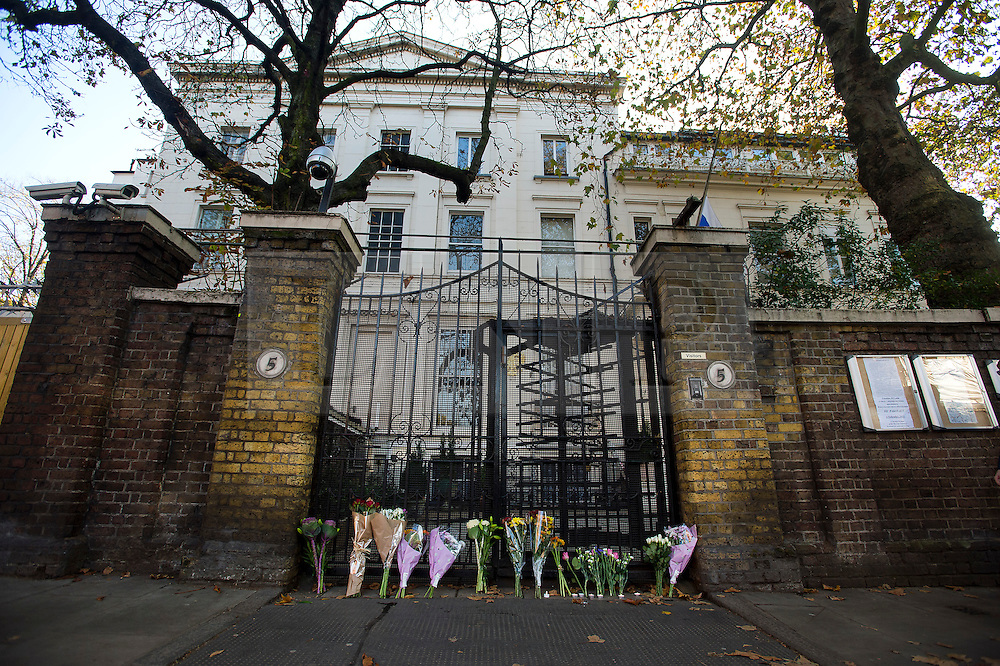 © Licensed to London News Pictures. 01/11/2015. London, UK. Flowers left at the gates to the Russian embassy in London following yesterdays plane crash in which a Russian passenger plane  flying from Sharm el Sheikh to St Petersburg crashed killing all the passengers and crew.  Photo credit: Ben Cawthra/LNP