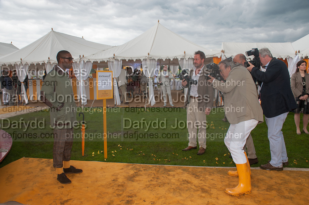 TINY TEMPAH AND PHOTOGRAPERS INC DAVE BENNET; IN VEUVE CLICQUOT WELLINGTONS, The Veuve Clicquot Gold Cup Final.<br /> Cowdray Park Polo Club, Midhurst, , West Sussex. 15 July 2012.
