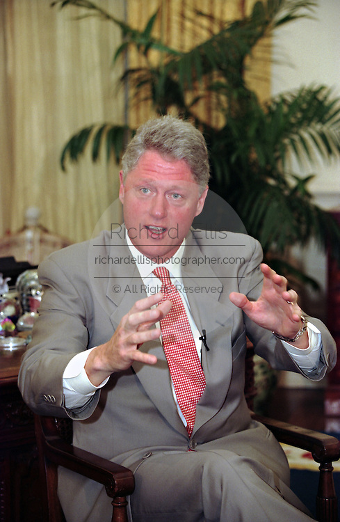 US President Bill Clinton during his weekly radio address on Social Security in the Oval Office July 29, 1995 in Washington, DC.