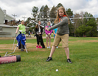 Elise Bengtson drives off the 9th tee at Bolduc Park Friday morning with fellow Fosters Golf campers.   (Karen Bobotas/for the Laconia Daily Sun)