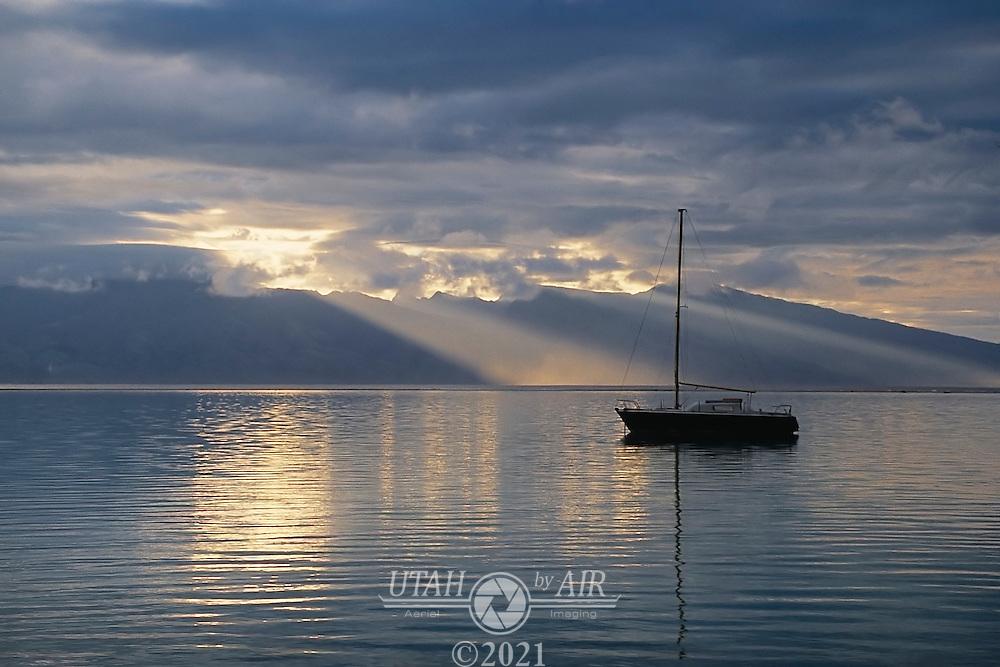Sailboat at dusk in Tahiti