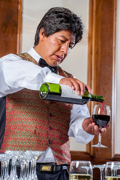 Bartender pouring wine at corporate event. Colorado