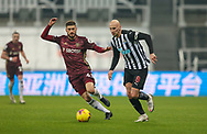 Leeds United midfielder Mateusz Klich (43) and Newcastle United midfielder Jonjo Shelvey (8)  during the Premier League match between Newcastle United and Leeds United at St. James's Park, Newcastle, England on 26 January 2021.