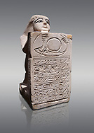 Ancient Egyptian stelophorus statue of Ubenre, New Kingdom, 19th-20th Dynasty, (1292-1076 BC), Deir el-Medina, Egyptian Museum, Turin. Cat 3040. Grey background.<br /> <br /> This type of stele is so called stelophorous statue. It consists of kneeling figure holding or offering stele. They were produced from the 18th dynasty onwards. Such stelae were usually inscribed with hymns to the sun-god. .<br /> <br /> If you prefer to buy from our ALAMY PHOTO LIBRARY  Collection visit : https://www.alamy.com/portfolio/paul-williams-funkystock/ancient-egyptian-art-artefacts.html  . Type -   Turin   - into the LOWER SEARCH WITHIN GALLERY box. Refine search by adding background colour, subject etc<br /> <br /> Visit our ANCIENT WORLD PHOTO COLLECTIONS for more photos to download or buy as wall art prints https://funkystock.photoshelter.com/gallery-collection/Ancient-World-Art-Antiquities-Historic-Sites-Pictures-Images-of/C00006u26yqSkDOM