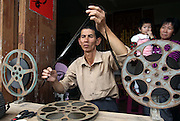 "ZHANGZHOU, CHINA - (CHINA OUT) <br /> <br /> ""Movie Theater"" In Rural China <br /> <br /> Movie projectionist Qiu Wensheng prepares to show a movie for villagers  in Zhangzhou, Fujian Province of China. There are many movie projectionists working in rural areas to show movies for farmers. <br /> ©Exclusivepix"