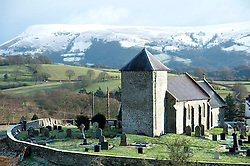 © Licensed to London News Pictures. 17/01/2015. St. Davids Church in the tiny hamlet of LLanddewi'r Cwm in Powys, Wales, nestles in a valley below the snowline. There was overnight snowfall on high land in Mid Wales. Mynydd Epynt, Powys , Wales, UK. Photo credit: Graham M. Lawrence/LNP