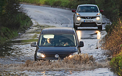 © Licensed to London News Pictures 27/12/2020.        Crockenhill, UK. The B258 near Crockenhill in Kent has deep flooding causing traffic problems for drivers. Storm Bella has battered Kent with gale force winds and heavy rain flooding roads and bringing down trees. Photo credit:Grant Falvey/LNP