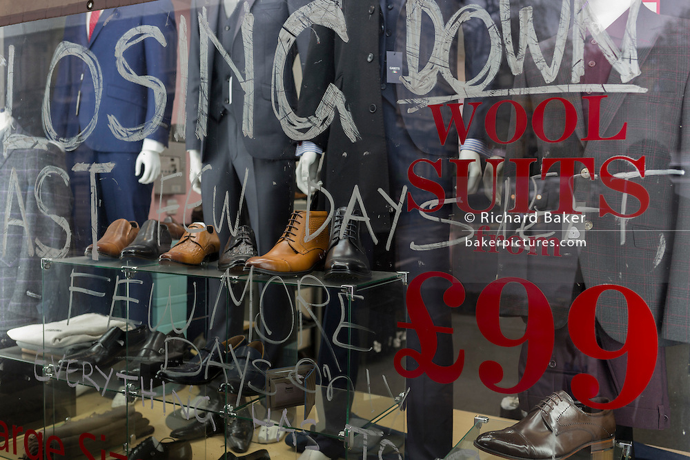 The shop window of a menswear retailer closing down soon, on 2nd February 2017, in the City of London, England.