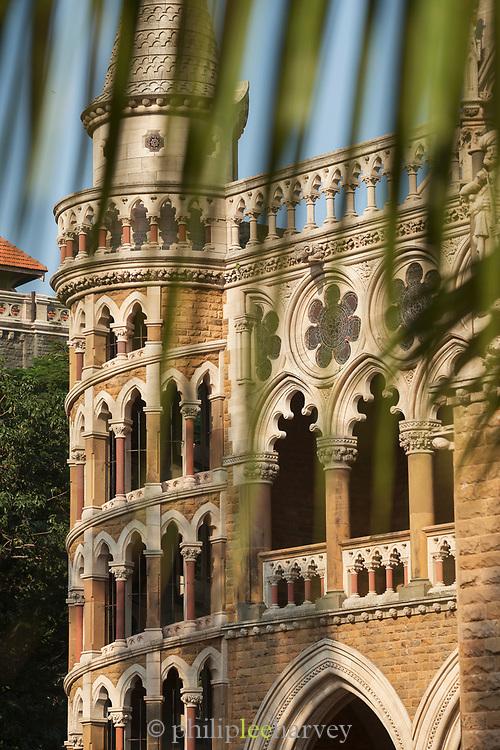 Selective focus on Mumbai High Court Building seen through leaves, Mumbai, India
