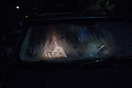 A woman sits in her car as she waits to enter the Remote Area Medical mobile clinic in Grundy, Virginia on October 7, 2017. This event was one of several weekend-long clinics held during the year by RAM, providing free dental, vision and general health services to hundreds of uninsured and underinsured people in remote areas of the United States.<br />  (photo by Toya Sarno Jordan)