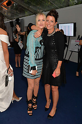 Left to right, LAURA WHITMORE and DAVINA McCALL at the Glamour Women of The Year Awards in Association with Next held in Berkeley Square Gardens, Berkeley Square, London on 3rd June 2014.