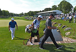 May 3, 2018 - Charlotte, NC, USA - Rory McIlroy leaves the 18th green to head to the front nine during he first round of the Wells Fargo Championship at Quail Hollow Club in Charlotte, N.C., on Thursday, May 3, 2018. (Credit Image: © Jeff Siner/TNS via ZUMA Wire)