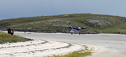 Barra Airport is a short-runway airport situated in the wide shallow bay of Traigh Mhòr at the north tip of the island of Barra in the Outer Hebrides, Scotland. Barra is now the only beach airport anywhere in the world to be used for scheduled airline services. Loganair Twin Otter taking off. (c) Stephen Lawson   Edinburgh Elite media
