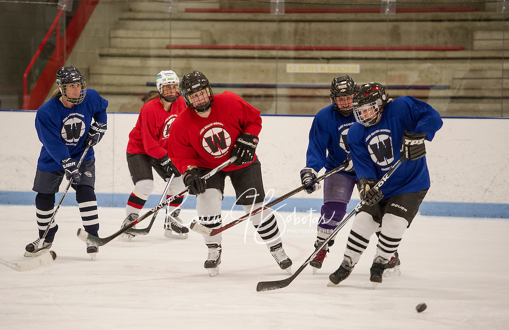 The Red and Blue teams battle it out on the ice during Tuesday evenings Lakes Region Womens Hockey Club at the Laconia Ice Arena.  (Karen Bobotas/for the Laconia Daily Sun)