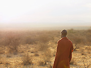 Maasai tribesman looking out over African plains near Amboseli National Park, Rift Valley Province, Kenya